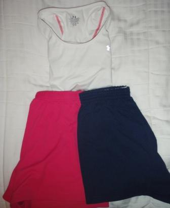 white with pink stripes under armor shirt, pink shorts, navy shorts